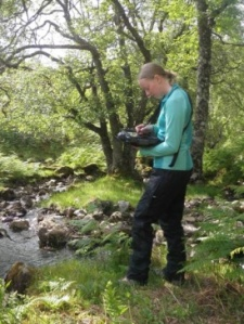 Female survey geologist on fieldwork in Scotland.