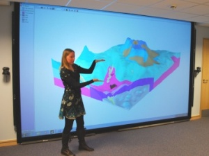 A female survey geologist using 3D mapping software.